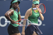 Sloane Stephens and doubles partner Eugenie Bouchard of Canada discuss their strategy in their doubles match against Kirsten Flipkens of Belgium and Daria Gavrilova of Russia on day four of the Rogers Cup at IGA Stadium on August 9, 2018 in Montreal, Quebec, Canada.