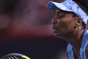 Venus Williams concentrates against Simona Halep of Romania on day four of the Rogers Cup at IGA Stadium on August 9, 2018 in Montreal, Quebec, Canada.