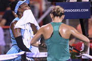 Venus Williams wipes herself down as she walks by Simona Halep of Romania during day four of the Rogers Cup at IGA Stadium on August 9, 2018 in Montreal, Quebec, Canada.