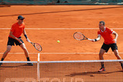 Jamie Murray of Great Britain and Bruno Soares of Brazil in action against Diego Schwartzman of Argentina and Joao Sousa of Portugal in their doubles quarter final match during day six of the Rolex Monte-Carlo Masters at Monte-Carlo Country Club on April 19, 2019 in Monte-Carlo, Monaco.