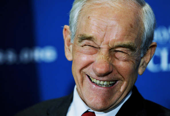 Ron Paul Republican presidential candidate U.S. Rep. Ron Paul (R-TX) smiles before speaking during a luncheon at the National Press Club on October 5, 2011 in Washington, DC.  In a new poll Paul is still lagging far behind frontrunners former Massachusetts Gov. Mitt Romney, businessman Herman Cain and Texas Gov. Rick Perry.