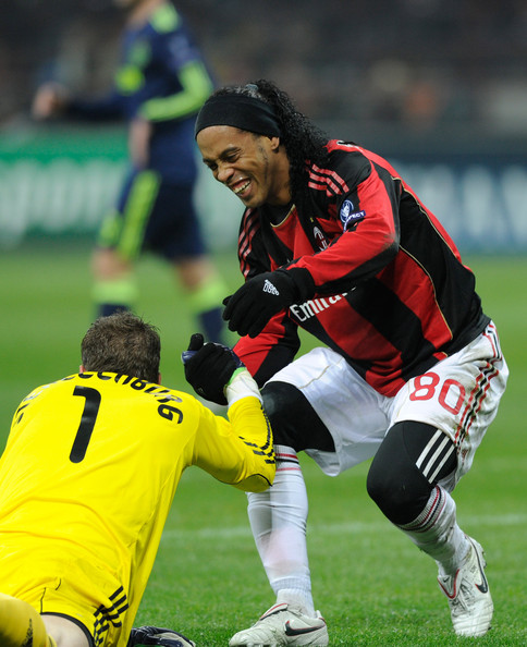 Ronaldinho Maarten Stekelenburg of AFC Ajax is helped up by Ronaldinho of AC Milan during the UEFA Champions League Group G match between AC Milan and AFC Ajax at Stadio Giuseppe Meazza on December 8, 2010 in Milan, Italy.