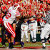 John Clay Photos - Running back John Clay #32 of the Wisconsin Badgers hands the ball to a referee after scoring a touchdown in the first quarter against the TCU Horned Frogs during the 97th Rose Bowl game on January 1, 2011 in Pasadena, California. - Rose Bowl Game - Wisconsin v TCU
