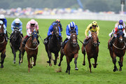 Paul Hanagan riding Mahsoob (Blue and White Strip hat) wins The Wolferton Handicap Stakes during Day 5 of Royal Ascot at Ascot Racecourse on June 20, 2015 in Ascot, England.