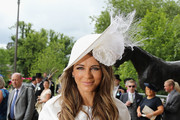 Elizabeth Hurley arrives at Royal Ascot 2016 at Ascot Racecourse on June 14, 2016 in Ascot, England. The cake hat was commissioned by bookmake Coral to celebrate the Queen's 90th Birthday.