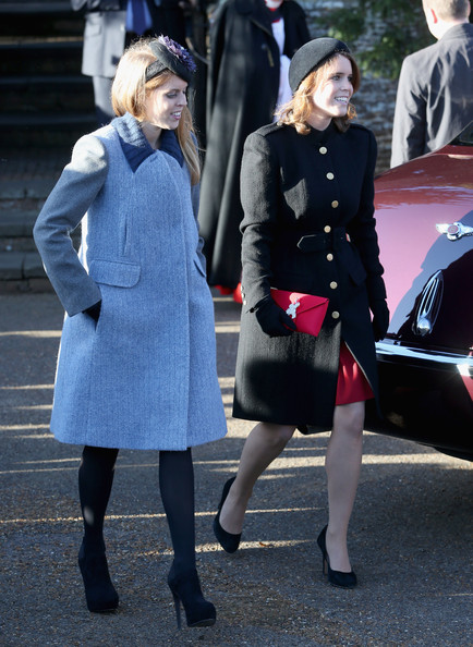 Princess Beatrice and Princess Eugenie leave the Christmas Day service at Sandringham on December 25, 2013 in King's Lynn, England.