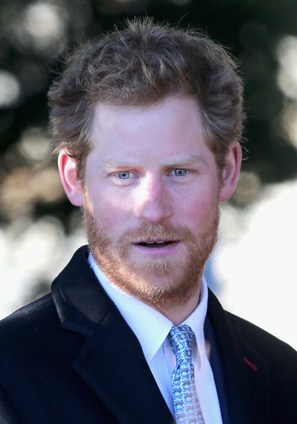Prince Harry leaves the Christmas Day service at Sandringham on December 25, 2013 in King's Lynn, England.