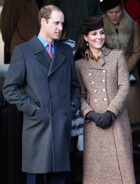 Prince William, Duke of Cambridge and Catherine, Duchess of Cambridge leave the Christmas Day Service at Sandringham Church on December 25, 2014 in King's Lynn, England.