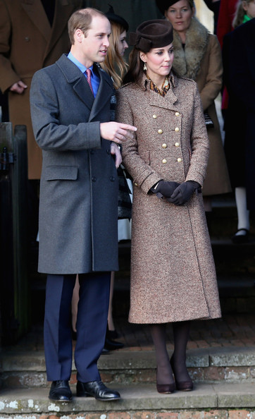 Catherine, Duchess of Cambridge and Prince William, Duke of Cambridge leave the Christmas Day Service at Sandringham Church on December 25, 2014 in King's Lynn, England.