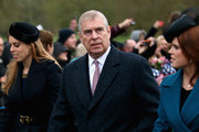 Prince Andrew, Duke of York and his daughter's Princess Beatrice and Princess Eugenie attends a Christmas Day church service at Sandringham on December 25, 2015 in King's Lynn, England.