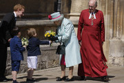 Britain's Queen Elizabeth II is presented with flowers as she leaves after attending the Easter Mattins Service at St George's Chapel on April 21, 2019 in Windsor, England.