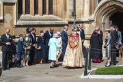 Members of the royal family greet Queen Elizabeth II as she arrives for the Easter Sunday service at St George's Chapel on April 21, 2019 in Windsor, England.