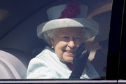 Britain's Queen Elizabeth II waves to the public as she leaves in a car after attending the Easter Mattins Service at St George's Chapel on April 21, 2019 in Windsor, England.