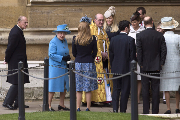 Queen Elizabeth II and Prince Philip, Duke of Edinburgh arrive to attend the Easter Sunday service at St George's Chapel at Windsor Castle on April 5, 2015 in Windsor, England.
