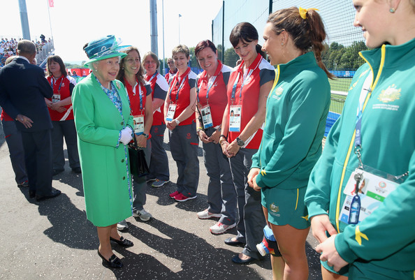 Queen Elizabeth II shares a joke with the Australian Hockey Team as she visits the Glasgow National Hockey Centre to watch the hockey during day one of 20th Commonwealth Games on July 24, 2014 in Glasgow, Scotland.