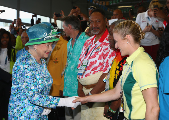 Queen Elizabeth II  is greeted by Australian athlete Sally Pearson during a visit to the Athletes Village during the Commonwealth games on July 24, 2014 in Glasgow, Scotland.