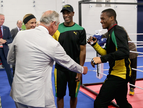 Prince Charles, Prince of Wales jokingly spars with a member of the Jamaican Commonwealth Boxing Team as he visits the Emirates Arena and Chris Hoy Velodrome ahead of the start of the Commonwealth games on July 23, 2014 in Glasgow, Scotland.