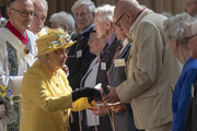 Queen Elizabeth II distributes the Maundy money at the traditional Royal Maundy Service at St George's Chapel on April 18, 2019 in Windsor, England.