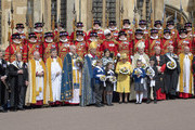 Queen Elizabeth II and Princess Eugenie of York hold nosegays as they attend the traditional Royal Maundy Service at St George's Chapel on April 18, 2019 in Windsor, England.