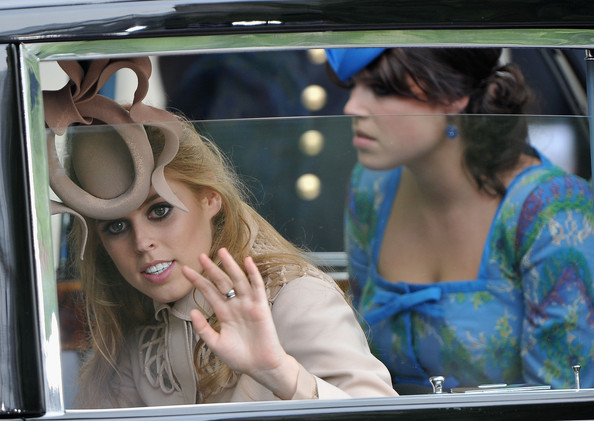 Princess Beatrice (L) of York and Princess Eugenie of York make the journey by carriage procession to Buckingham Palace following the Royal Wedding of Prince William, Duke of Cambridge and Catherine, Duchess of Cambridge at Westminster Abbey on April 29, 2011 in London, England. The marriage of the second in line to the British throne was led by the Archbishop of Canterbury and was attended by 1900 guests, including foreign Royal family members and heads of state. Thousands of well-wishers from around the world have also flocked to London to witness the spectacle and pageantry of the Royal Wedding.