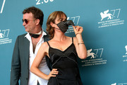 """Thomas Jane and Radha Mitchell, wearing face mask, attend the photocall of the movie """"Run Hide Fight"""" at the 77th Venice Film Festival on September 10, 2020 in Venice, Italy."""