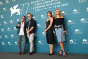"""(L-R) Thomas Jane, Director Kyle Rankin, Radha Mitchell and Isabel May attend the photocall of the movie """"Run Hide Fight"""" at the 77th Venice Film Festival on September 10, 2020 in Venice, Italy."""