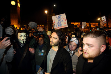 Russell Brand Protesters Gather for Million Mask March