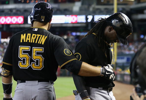 Russell Martin Andrew McCutchen #22 (R) of the Pittsburgh Pirates holds his side as he walks off the field after batting against the Arizona Diamondbacks during the eighth inning of the MLB game at Chase Field on August 3, 2014 in Phoenix, Arizona.