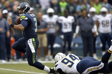 Russell Wilson Corey Liuget San Diego Chargers v Seattle Seahawks