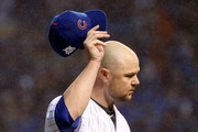 Jon Lester #34 of the Chicago Cubs acknowledges the crowd after being relieved in the eighth inning during game four of the National League Division Series against the Washington Nationals at Wrigley Field on October 11, 2017 in Chicago, Illinois.