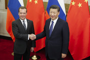 Chinese President Xi Jinping and Russian Prime Minister Dmitry Medvedev shake hands before talks at the Diaoyutai state guesthouse on November 1, 2017 in Beijing, China. Medvedev is on an official three-day visit to China.