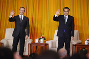 Chinese Premier Li Keqiang and Russian Prime Minister Dmitry Medvedev wave after the closing ceremony of a China-Russia media cooperation program at the Great Hall of the People on November 1, 2017 in Beijing, China. Medvedev is on an official three-day visit to China.