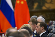 Russian Prime Minister Dmitry Medvedev (R) attends talks with Chinese Premier Li Keqiang (not pictured) at the Great Hall of the People in Beijing on November 1, 2017.  / AFP PHOTO / POOL / THOMAS PETER