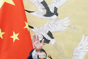 Chinese Premier Li Keqiang waves as leaves a signing ceremony he attended with Russian Prime Minister Dmitry Medvedev at the Great Hall of the People on November 1, 2017 in Beijing, China.