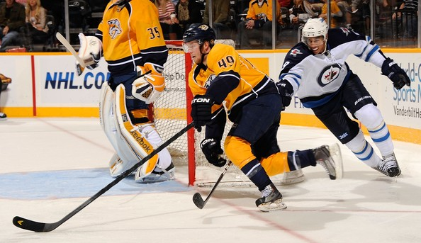Ryan Ellis Ryan Ellis #49 of the Nashville Predators carries the puck past Evander Kane #9 of the Winnipeg Jets at Bridgestone Arena on September 24, 2011 in Nashville, Tennessee.