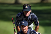 Webb Simpson and Bubba Watson of the USA line up a putt on the tenth green during day two of the Afternoon Four-Ball Matches for The 39th Ryder Cup at Medinah Country Club on September 29, 2012 in Medinah, Illinois.