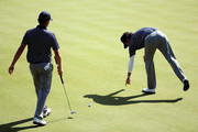 Webb Simpson and Bubba Watson of the USA line up a putt on the 18th green during day two of the Morning Foursome Matches for The 39th Ryder Cup at Medinah Country Club on September 29, 2012 in Medinah, Illinois.