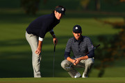 Webb Simpson and Bubba Watson of the USA wait on the fourth green during day two of the Morning Foursome Matches for The 39th Ryder Cup at Medinah Country Club on September 29, 2012 in Medinah, Illinois.