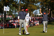 Bubba Watson and Webb Simpson of the USA walk across the 14th green during day two of the Morning Foursome Matches for The 39th Ryder Cup at Medinah Country Club on September 29, 2012 in Medinah, Illinois.