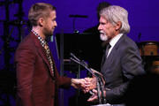 Harrison Ford (R) accepts the Artists Inspiration Award from Ryan Gosling onstage at the SAG-AFTRA Foundation's 3rd Annual Patron of the Artists Awards at the Wallis Annenberg Center for the Performing Arts on November 8, 2018 in Beverly Hills, California.