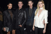 (L-R) Model Sami Miro, in Saint Laurent by Hedi Slimane, and actors Zac Efron, Will Peltz and Nicola Peltz, in Saint Laurent by Hedi Slimane, attend Saint Laurent at the Palladium on February 10, 2016 in Los Angeles, California for the Saint Laurent Los Angeles show.