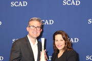 Actress Lili Taylor poses with her Icon award together with presenter Brennen Dicker during Icon Award & Spotlight Cast Award Presentations during aTVfest  2016 presented by SCAD on February 5, 2016 in Atlanta, Georgia.