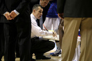 Head coach Billy Donovan of the Florida Gators points to a play on his clipboard as he addresses his team during a timeout against the Auburn Tigers during the first round of the SEC Men's Basketball Tournament at the Bridgestone Arena on March 11, 2010 in Nashville, Tennessee.