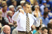 Head coach Billy Donovan of the Florida Gators signals to his players in the second half against the Alabama Crimson Tide during the semifinals of the SEC Baketball Tournament at Bridgestone Arena on March 16, 2013 in Nashville, Tennessee.
