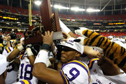 Jordan Jefferson #9 of the LSU Tigers helps carry the 2011 SEC Championship trophy after their 42-10 win over the Georgia Bulldogs  at Georgia Dome on December 3, 2011 in Atlanta, Georgia.