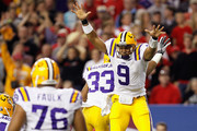 Jordan Jefferson #9 and Odell Beckham Jr. #33 of the LSU Tigers celebrate on a play which they thought scored a touchdown but the play was called back in the third quarter against the Georgia Bulldogs during the 2011 SEC Conference Championship at  Georgia Dome on December 3, 2011 in Atlanta, Georgia.