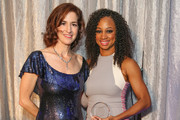 Actresses Monique Coleman (R) presents an award to honoree Jessica Greer Morris at the 6th annual SELF Magazine's Women Doing Good Awards at Apella on September 11, 2013 in New York City.