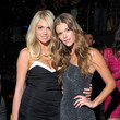 She cozies up with Nina Agdal.
