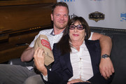 Jim Parrack and Anjelica Huston pose for a photo before the world premiere of the film 'Trouble' at Egyptian Theater, Seattle on June 7, 2017 in Seattle, Washington.