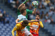 The goalkeeper Alberto Brignoli with his teammates of Benevento Calcio competes for the ball with Lucas leiva of SS Lazio during the Serie A match between SS Lazio and Benevento Calcio at Stadio Olimpico on March 31, 2018.